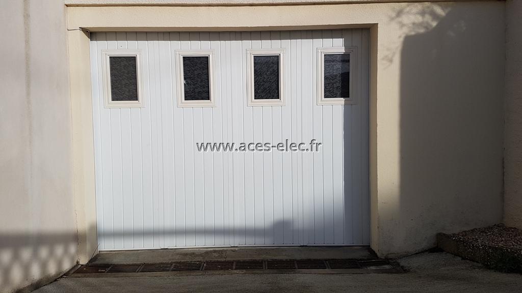 Porte de garage sur mesure sur système coulissant à Cholet